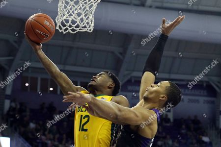 Stock Image of Baylor guard Jared Butler (12) goes up for a shot against TCU forward Jaedon LeDee (23) during the first half an NCAA college basketball game on in Fort Worth, Texas