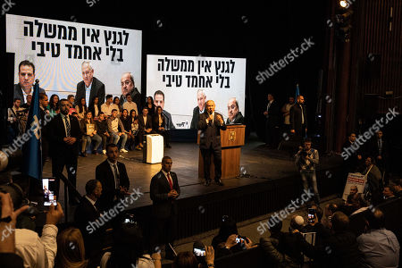 """Israeli Prime Minister Benjamin Netanyahu addresses his Likud party supporters during an election campaign rally in Ramat Gan, Israel, . The Hebrew writing say """"Gantz don't have government without Ahmad Tibi"""