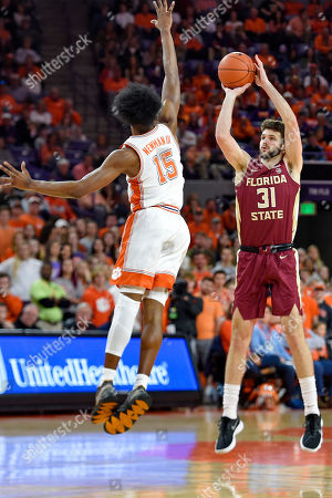 Stock Photo of Florida State's Wyatt Wilkes, right, shoots while defended by Clemson's John Newman lll during the first half of an NCAA college basketball game in Columbia, S.C