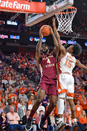 Florida State's Patrick Williams (4) shoots while defended by Clemson's John Newman lll during the first half of an NCAA college basketball game in Columbia, S.C