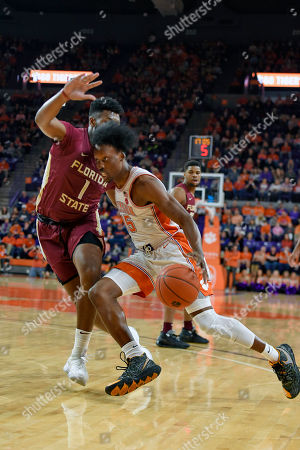 Stock Image of Clemson's John Newman lll, right, drives while defended by Florida State's RaiQuan Gray during the first half of an NCAA college basketball game, in Clemson, S.C