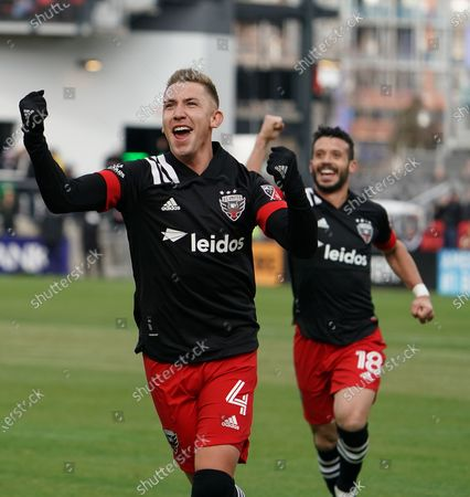 Stock Picture of Russell Canouse (#4) and Felipe Martins (#18) of DC United celebrate after Canouse scored a second period goal against the Colorado Rapids at Audi Field in Washington, DC