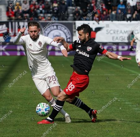 Sam Nicholson (#28) of the Colorado Rapids and Felipe Martins of DC United in action on opening day of the MLS at Audi Field in Washington, DC