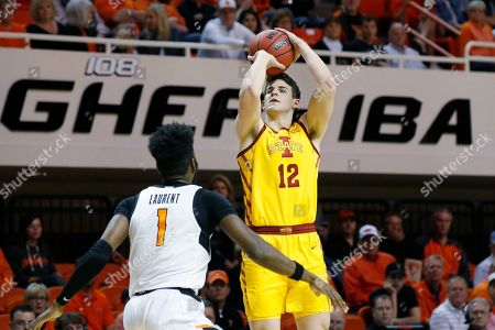 Iowa State forward Michael Jacobson (12) shoots over Oklahoma State guard Jonathan Laurent (1) in the second half of an NCAA college basketball game in Stillwater, Okla