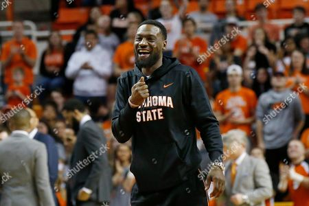 Former Oklahoma State and NBA basketball player Tony Allen smiles and gestures as he is introduced to fans during an NCAA college basketball game between Iowa State and Oklahoma State in Stillwater, Okla