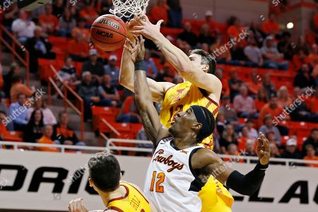 Iowa State forward Michael Jacobson, top, and forward Cameron McGriff (12) reach for the ball in the first half of an NCAA college basketball game in Stillwater, Okla