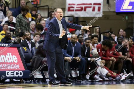 Oklahoma coach Lon Kruger reacts during the second half of an NCAA college basketball game against West Virginia, in Morgantown, W.Va