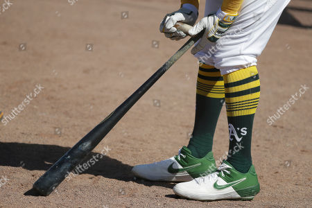 Oakland Athletics' Khris Davis waits to hit during the fourth inning of a spring training baseball game against the Cleveland Indians, in Mesa, Ariz