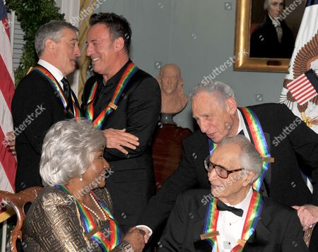Robert De Niro and Bruce Springsteen, upper left, embrace as Mel Brooks congratulates Grace Bumbry