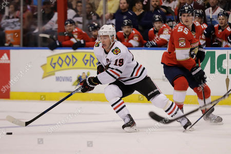 Nick Bjugstad, Jonathan Toews. Chicago Blackhawks center Jonathan Toews (19) reacts after he missed the puck during the first period of an NHL hockey game against the Florida Panthers, in Sunrise, Fla