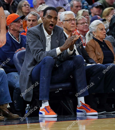 Former Virginia player Ralph Sampson watches from the sidelines during an NCAA college basketball game against Duke, in Charlottesville, Va