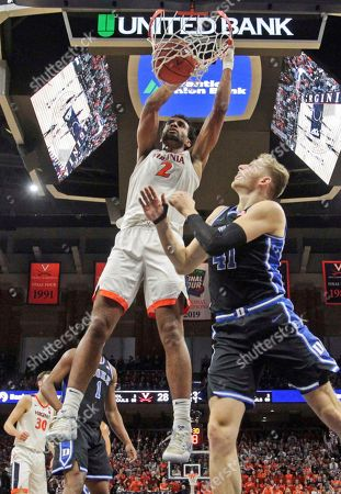 Virginia guard Braxton Key (2) dunks the ball over Duke forward Jack White (41) during the second half of an NCAA college basketball game, in Charlottesville, Va. Virginia defeated Duke 52-50