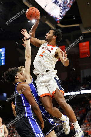 Virginia guard Braxton Key (2) shoots over Duke center Vernon Carey Jr. (1) and Duke forward Jack White (41) during the second half of an NCAA college basketball game, in Charlottesville, Va. Virginia defeated Duke 52-50