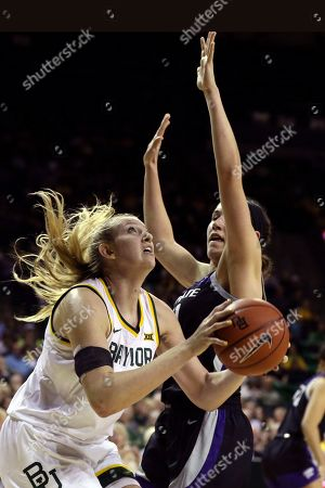 Stock Picture of Baylor forward Lauren Cox, left, scores past Kansas State forward Peyton Williams, right, in the first half of an NCAA college basketball game, in Waco, Texas