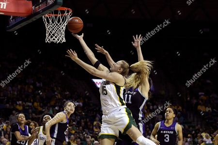 Stock Image of Baylor forward Lauren Cox, center left, scores past Kansas State forward Peyton Williams, center right, in the second half of an NCAA college basketball game, in Waco, Texas