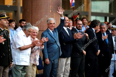The President of Uruguay Tabare Vazquez (C), together with former President Jose Mujica (2-L), takes part in a ceremony of the National Pavilion to receive the national flag, in the Plaza Independencia in Montevideo, Uruguay, 29 February 2020. Vazquez, who served as Uruguay's 39th and 41st President, will be replaced by president-elect of Uruguay, Luis Lacalle Pou, on 01 March 2020.