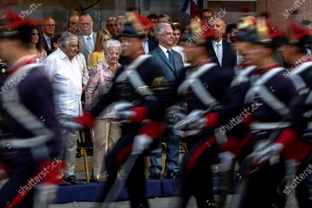 The President of Uruguay Tabare Vazquez (C), together with former President Jose Mujica (L), takes part in a ceremony of the National Pavilion to receive the national flag, in the Plaza Independencia in Montevideo, Uruguay, 29 February 2020. Vazquez, who served as Uruguay's 39th and 41st President, will be replaced by president-elect of Uruguay, Luis Lacalle Pou, on 01 March 2020.