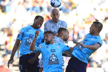 Oscar Murillo, Franco Jara and Luis Chavez of Pachuca vie for the ball with Ariel Nahuelpan of Queretaro during a day eight Clausura 2020 tournament match between Tuzos del Pachuca and Gallos de Queretaro at the Hidalgo de Pachuca Stadium, Mexico, 29 February 2020.