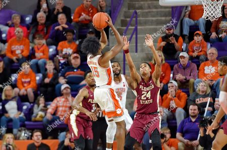 Clemson's John Newman lll shoots in the closing minutes of the second half of an NCAA college basketball game against Florida State, in Clemson, S.C. Clemson won 70-69