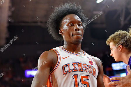 Clemson's John Newman lll takes a break and heads to the bench during the first half of an NCAA college basketball game against Florida State, in Clemson, S.C. Clemson won 70-69