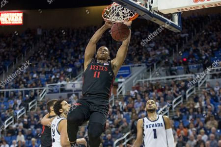 Stock Photo of San Diego State forward Matt Mitchell (11) dunks the ball during the first half of an NCAA college basketball game against Nevada in Reno, Nev