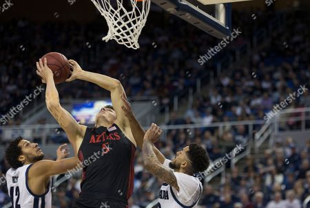 San Diego State forward Yanni Wetzell (5) shoots over the Nevada defense during the second half of an NCAA college basketball game at Lawlor Events Center in Reno, Nev