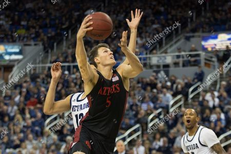 San Diego State forward Yanni Wetzell (5) shoots against Nevada during the second half of an NCAA college basketball game at Lawlor Events Center in Reno, Nev