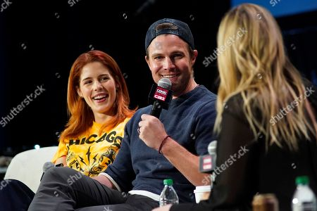 Stock Picture of Emily Bett Rickards, Stephen Amell. Emily Bett Rickards, left, and Stephen Amell participate on day 2 during 'A Farewell to Arrow' panel at C2E2 at McCormick Place on in Chicago