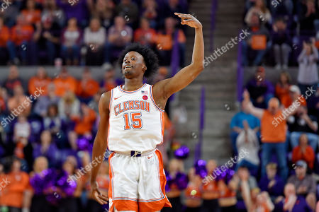 Stock Picture of JohnNewman lll. Clemson's John Newman lll reacts after making a three-point shot during the first half of an NCAA college basketball game against Florida State, in Columbia, S.C