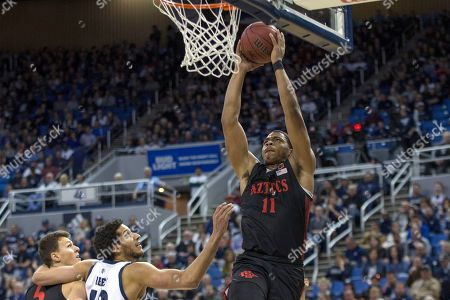 San Diego State forward Matt Mitchell (11) dunks the ball against Nevada during the first half of a basketball game played at Lawlor Events Center in Reno, Nev