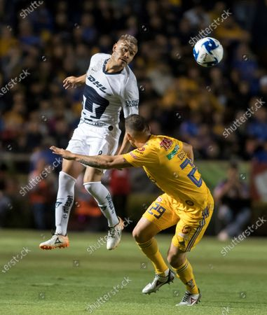 Jesus Duenas (R) of Tigres fights for the ball with Pablo Barrera (L) of Pumas during a day eight match of the Clausura 2020 Tournament held at the University Stadium in Monterrey, Mexico, 29 February 2020.