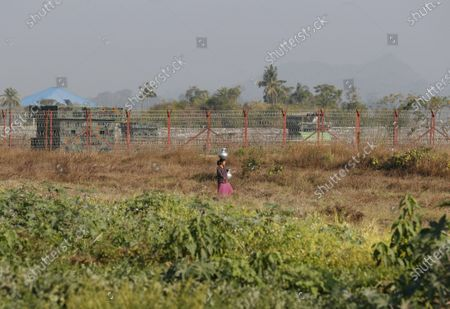 A Rakhine ethnic woman carries water near the Inn Din police outpost in Maungdaw township, Rakhine State, Myanmar, 29 February 2020 (issued 01 March 2020). According to media reports, the Maldives has hired Amal Clooney to represent it at the International Court of Justice (ICJ) in support of the Rohingya minority of Myanmar. The Maldives' Minister of Foreign Affairs Abdulla Shahid on 25 February announced that the country will formally join The Gambia in challenging Myanmar's military crackdown on the persecuted Muslim minority.