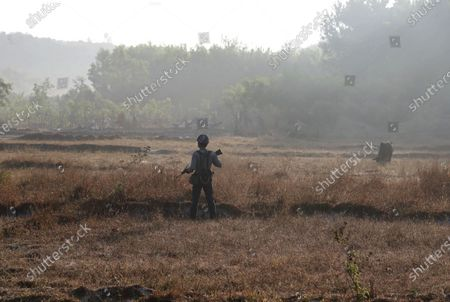 A police officer stands guard beside the road in Maungdaw township, Rakhine State, Myanmar, 29 February 2020 (issued 01 March 2020). According to media reports, the Maldives has hired Amal Clooney to represent it at the International Court of Justice (ICJ) in support of the Rohingya minority of Myanmar. The Maldives' Minister of Foreign Affairs Abdulla Shahid on 25 February announced that the country will formally join The Gambia in challenging Myanmar's military crackdown on the persecuted Muslim minority.