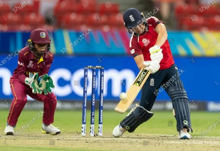 Stock Photo of Katherine Brunt of England (R) bats during the Women's T20 World Cup cricket match between England and the West Indies at Sydney Showground Stadium in Sydney, New South Wales, Australia, 01 March 2020.
