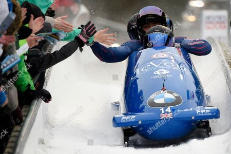 Team Brad Hall, Lawrence Taylor, Luke Dawes and Greg Cackett of Britain arrive the finish area during the four-man bobsled race at the Bobsleigh and Skeleton World Championships in Altenberg, eastern Germany