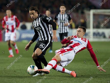 Milan Rodic of Crvena Zvezda competes against Lazar Markovic of Partizan