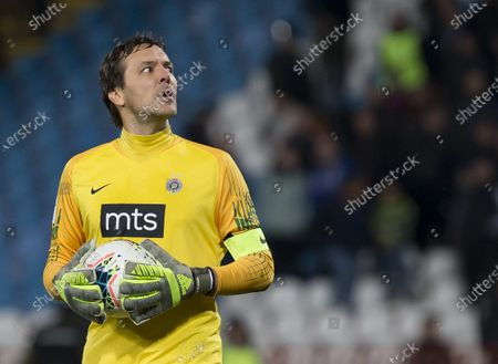 Goalkeeper Vladimir Stojkovic of Partizan looks at the at the result