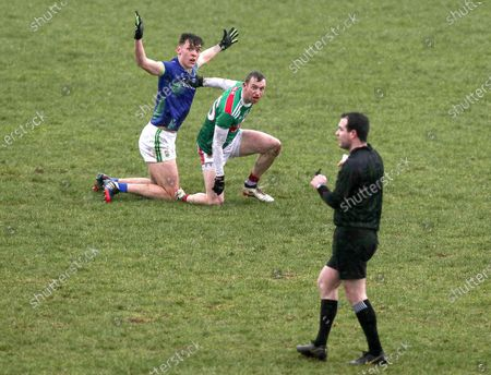 Mayo vs Kerry. Mayo's Keith Higgins with David Clifford of Kerry