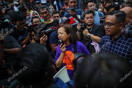 Marina (C), a daughter of former prime minister Mahathir Mohammad speaks during a demonstration to protest the ejection of the democratically elected government in Kuala Lumpur, Malaysia, 01 March 2020. The Yang di-Pertuan Agong (ruling monarch of Malaysia) Abdullah of Pahang named Muhyiddin the country's new premier on 29 February 2020 following the resignation of his predecessor, 94-year-old Mahathir Mohamad, a week earlier.
