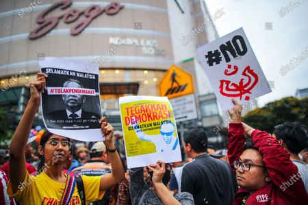 Protesters gather during a demonstration to protest the ejection of the democratically elected government in Kuala Lumpur, Malaysia, 01 March 2020. The Yang di-Pertuan Agong (ruling monarch of Malaysia) Abdullah of Pahang named Muhyiddin the country's new premier on 29 February 2020 following the resignation of his predecessor, 94-year-old Mahathir Mohamad, a week earlier.