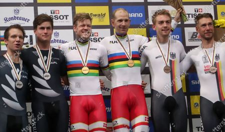 Stock Image of (L-R) Silver medalists Aaron Gate and Campbell Stewart of New Zealand, Gold medalists Lasse Hansen and Michael Morkov of Denmark and Bronze medalists Theo Reinhardt of Germany and Roger Kluge of Germany during the Men's Madison Final Victoy Ceremony at the UCI Track Cycling World Championships at the Velodrom in Berlin, Germany, 01 March 2020.