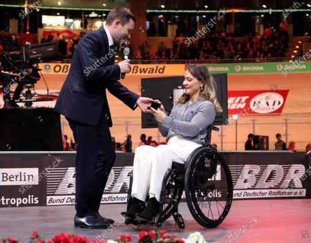 Stock Photo of German former track cyclist Kristina Vogel (R) receives the UCI Merit from UCI President David Lappartient (L) at the UCI Track Cycling World Championships at the Velodrom in Berlin, Germany, 01 March 2020.