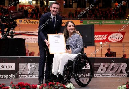 Stock Image of German former track cyclist Kristina Vogel (R) receives the UCI Merit from UCI President David Lappartient (L) at the UCI Track Cycling World Championships at the Velodrom in Berlin, Germany, 01 March 2020.