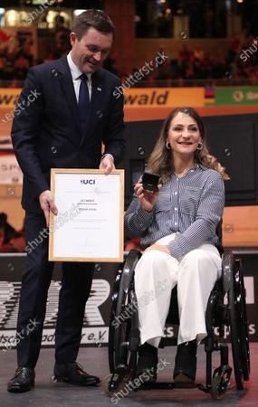 Stock Picture of German former track cyclist Kristina Vogel (R) receives the UCI Merit from UCI President David Lappartient (L) at the UCI Track Cycling World Championships at the Velodrom in Berlin, Germany, 01 March 2020.