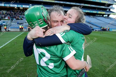 Sarsfields vs Slaughtneil. Sarfields manager Michael McGrath celebrates after the game with Sarah Spellman and Sinead Cannon