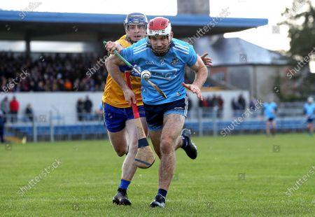 Clare vs Dublin. Clare's Podge Collins tackles Paddy Smyth of Dublin