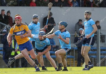 Clare vs Dublin. Clare's Domhnall McMahon is tackled by Sean Moran and Rian McBride of Dublin