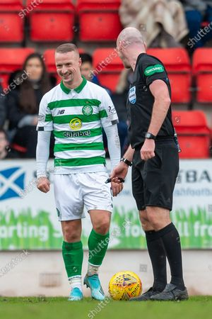 Stock Photo of Leigh Griffiths (#9) of Celtic FC shares a joke with referee John Beaton during the William Hill Scottish Cup quarter final match between St Johnstone and Celtic at McDiarmid Stadium, Perth