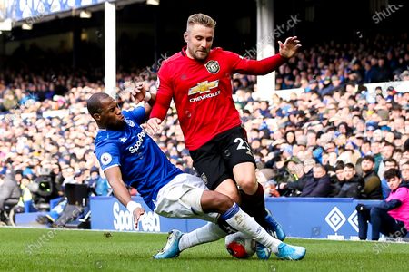 Luke Shaw of Manchester United is tackled by Djibril Sidibe of Everton