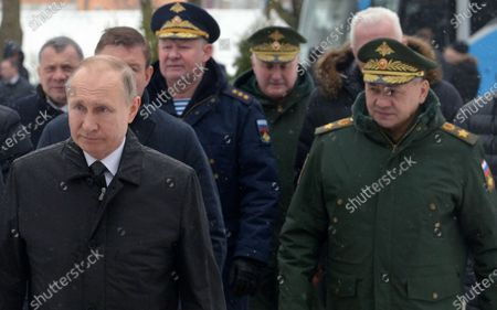 Russian President Vladimir Putin (L) and Defence Minister Sergey Shoygu (R) take part in a wreath-laying ceremony to the monument to paratroopers of the 6th airborne troops company of the 76 Pskov Airborne troops division, who perished in an anti-terrorist operation in Chechnya in 2000, in Pskov, Russia, 01 March 2020.